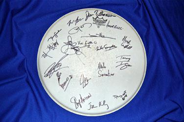 Charity Auction Alert: Autographed Neil Peart Drum Head